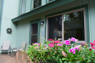 Front porch with mid summer flowers