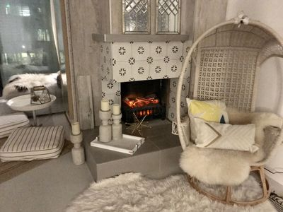 I inserted an electric fireplace for romance & warmth for  chilly Denver nights