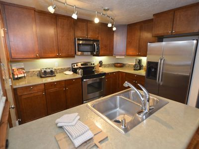 Photo for Relax in this charming condo, pets welcome, close to Village