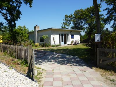 Photo for The bungalow is situated in a quiet park, out in the green. Pets welcome