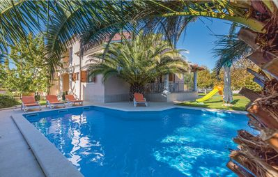 Photo for Beautiful villa with swimming pool, sauna, 300 m from the beach, WiFi, barbecue