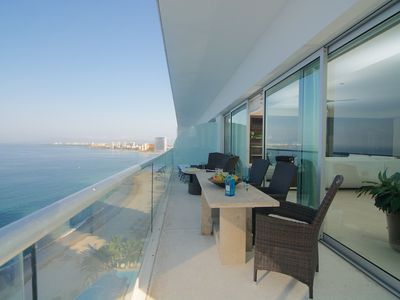 Photo for Luxury beachfront condo 3/3.5 corner unit huge terrace superb location