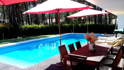 Pool with sunbathing and outside dining area
