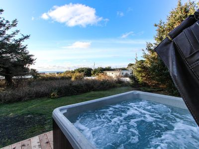 Photo for Cute cottage-style home, with private hot tub, and close to the beach & town!