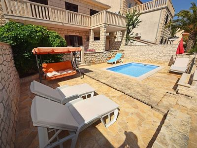 Photo for Apartment in the center of Supetar with Parking, Internet, Air conditioning, Pool (122741)