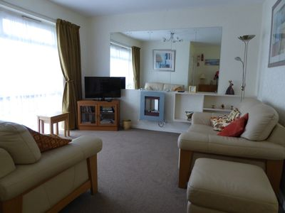Lounge with 2 leather settees, 32 inch flat screen TV