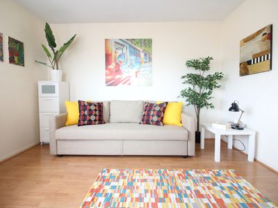 Photo for Sunny modern flat with terrace, 7 min to center of Paris