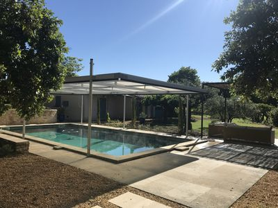 Photo for Boutique home with air con, short walk into town, big garden with large pool,