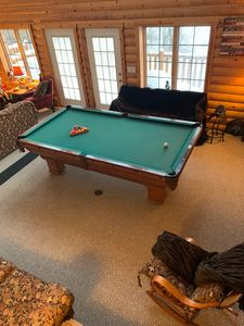 Enjoy the 134 yr old antique pool table and other games and activities near by