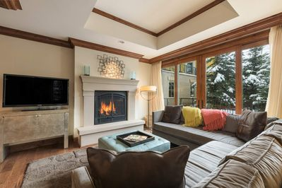 There's a gas fireplace in the main living area, a flat screen TV, and plenty of seating.