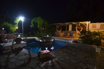 grden and pool at night