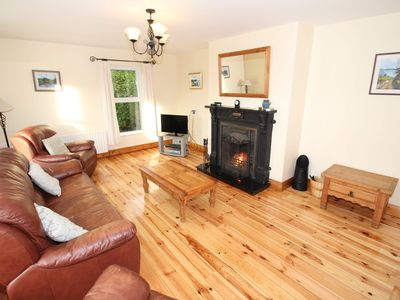 Photo for Kinnegar beach cottage has private access to sandy beach from rear of cottage