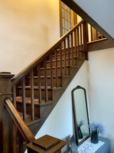 Front staircase leading to the second floor apartment