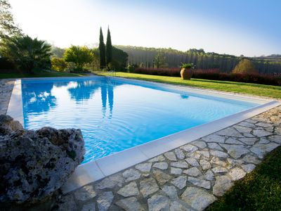 Photo for Apartment (Itin) in a small village, communal pool and views of San Gimignano