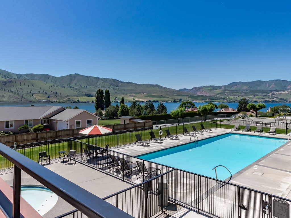 Bright, waterfront condo with lake and mountain views, shared pools ...