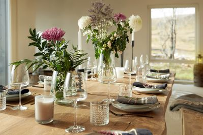 Our beautiful oak dining table seats 12-14 guests.