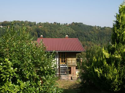 Photo for Detached holiday home on wooded hill with magnificent view