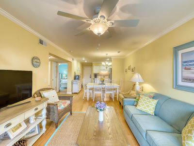 Photo for Renovated villa w/ community pool, ocean view across from the beach!