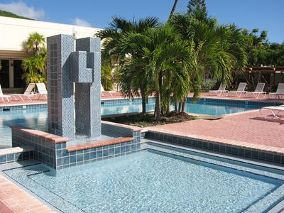 Photo for Beautifully newly renovated 3 BR/4 BA condo footsteps from the beach