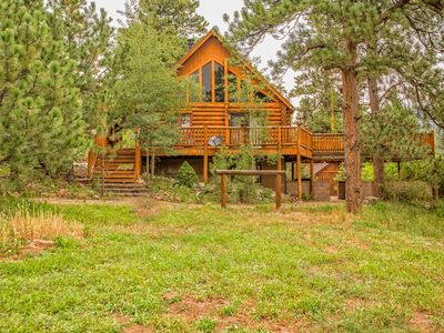 Photo for Secluded Log Cabin ** Stream & Lake ** Hot Tub ** ATV ** Wet bar ** Crafting **