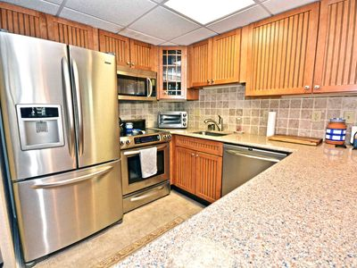 Photo for 2 bedroom condo with up-to-date styles and free WiFi just a mere stroll to the beach among the downtown excitement and a few streets from the Boardwalk!