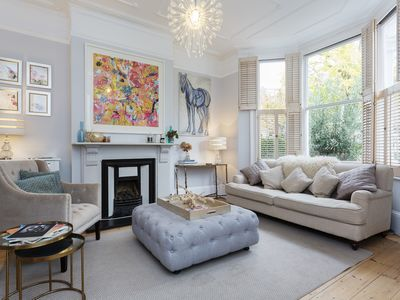 Photo for Stylishly designed 3 bed with patio and roof garden, in lovely Wandsworth- Veeve