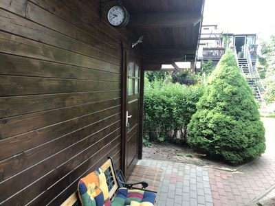 Photo for Cozy log cabin next to the koi pond in the middle of the garden