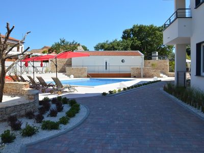 Photo for Apartment in the center of Peroj with Internet, Pool, Air conditioning, Parking (692784)