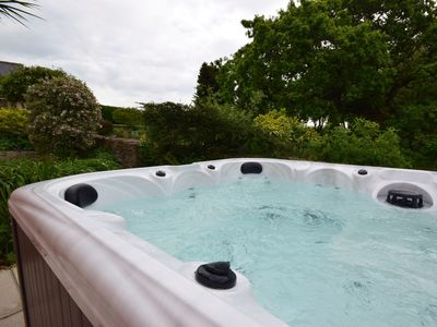 Enjoy the private hot tub over looking the garden