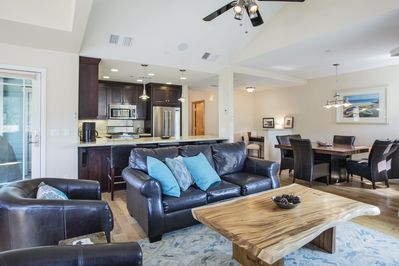 Open concept with dining table, bar seating and a desk.