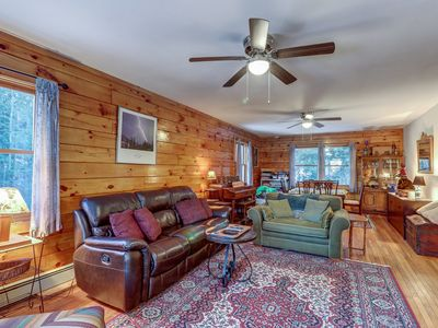 Photo for Charming log house with dock and kayaks, walk to beach access
