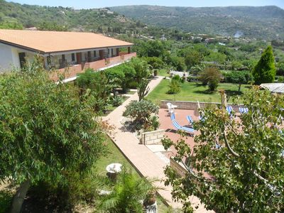 Photo for Cozy residence with large garden and swimming pool 600 meters from the sea