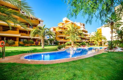 Photo for 2 bedroom Apartment, sleeps 4 in Punta Prima with Pool, Air Con and WiFi