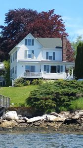 Perched on knoll with incredible waterfront views.