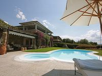 A beautiful home with a gorgeous garden & pool area