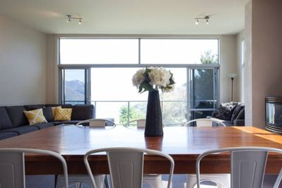 Dining table and open plan lounge