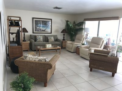 Large (Freshly painted)  living area w recliners and sleeper sofa.