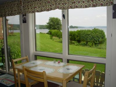 Watch the loon, and otters from the 4 season sunroom's glass window walls