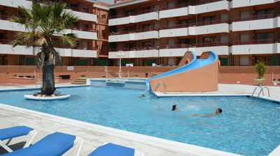 Photo for Upper Floor Apartment with Balcony + Wi-Fi   Outdoor Pool!