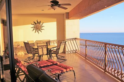 Balcony - outdoor dining table, chaise lounge chairs and plenty of seating.