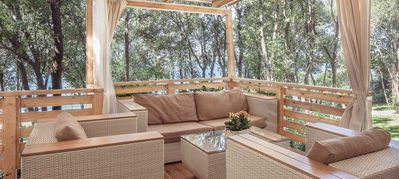 Photo for Mobilehome with covered terrace directly on the beach