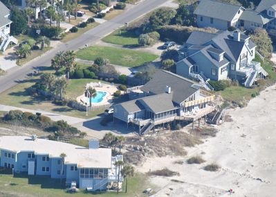 Our house is located right on the beach and features a pool and hot tub.