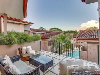 Photo for Upscale condo with shared pool & resort amenities, close to beach!