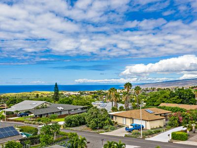 Photo for NEW LISTING!Breezy, updated home w/shared pools lanai, ocean view - walk to golf