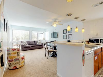 Photo for Beautiful condo w/ shared pool & tennis courts! Playground & game room on-site!