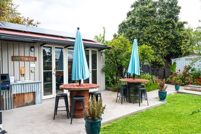 Enjoy outdoor living spaces including sunroom, bbq, chooks and veggie gardens