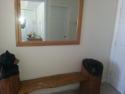 Hand carved bear bench seat in foyer. Welcome to our villa! Enjoy your stay!!