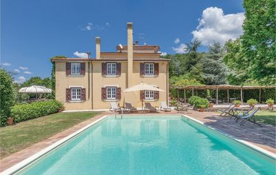 Photo for Exclusive villa with pool and garden on the side of a hill