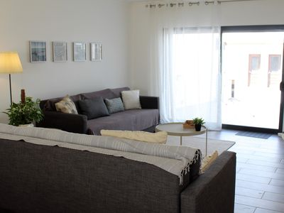 Photo for lovely spacious 3 bed townhouse over 3 floors, with jacuzzi, 200 metres to beach