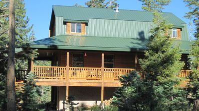 Wow, a huge wrap-around covered deck, big yard area, & fire pit for your s'mores